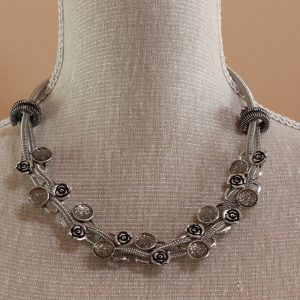 metal flower and faceted metal necklace